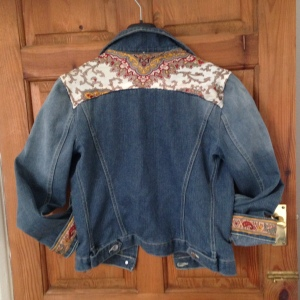 Denim jacket with vintage paisley silk scarf detail on back, cuffs and pockets.